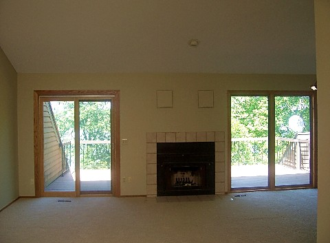 living room with double walkout to deck