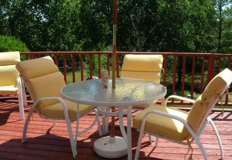 This affordable eden prairie home has a beautiful deck with views of trees