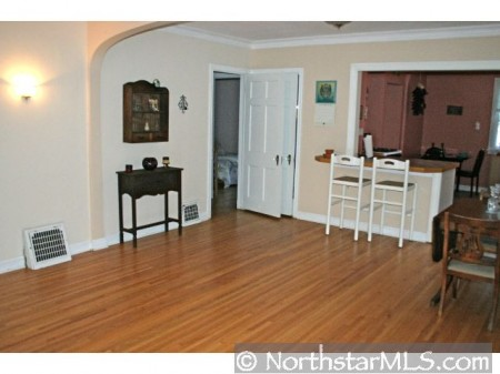 Alcoved entryways, hardwood floors, and a passthru!