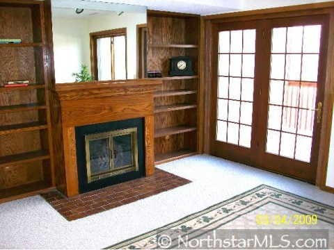 South MPLS condo has fabulous built-ins and fireplace.